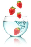 Falling strawberries Royalty Free Stock Photography