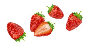 Falling strawberries isolated on white background. With clipping path royalty free stock photography