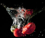 Falling strawberries Royalty Free Stock Images