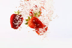Falling strawberries in water Royalty Free Stock Image