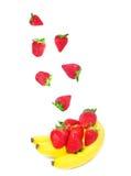 Falling strawberry and bananas Stock Photo