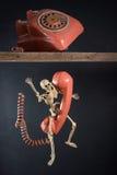 Falling telephone Stock Image
