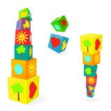 Falling tower of colorful childish play cubes Royalty Free Stock Images