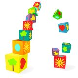 Falling tower of colorful childish play cubes Stock Photo