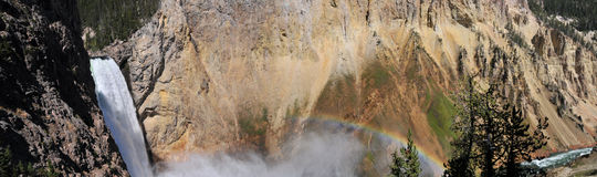 Falling Tranquility. Rainbow Above Yellowstone's Lower Falls Stock Photo