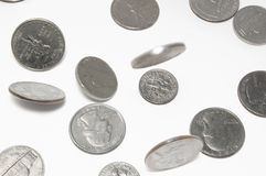 Falling US coins on isolated background Stock Image