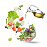 Falling Vegetables For Salad And Oil Isolated Royalty Free Stock Photography