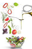 Falling vegetables for salad and oil isolated Stock Photos