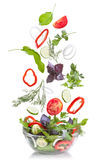 Falling vegetables for salad on white Royalty Free Stock Image