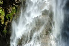 Falling water, abstract nature background. Waterfall in Himalayas