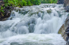 falling water in the morning mist. Stock Images