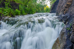 falling water in the morning mist. Stock Photo