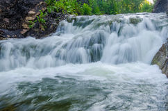 falling water in the morning mist. Royalty Free Stock Photography