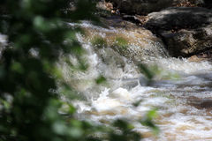 Falling water on the Santa Fe River. A small waterfall on the Santa Fe river in the city Stock Photo