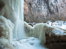 Falling water stream has formed ice crust Stock Images