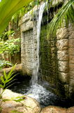 Carved Stone Waterfall in the Rain Forest. Waterfall, Nevis Botanical Gardens, Waterfall, rock face. tranquil garden Stock Photo