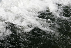 Falling waterfall water. White foam Stock Photos