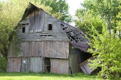 Falling wooden barn Royalty Free Stock Photo