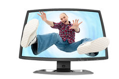 Falling young man into the screen Stock Image