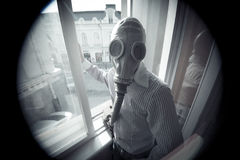 Fallout. The man wearing old-timed gas mask, styled with Fallout theme Stock Photo