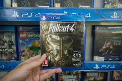 Fallout 4. Bratislava, Slovakia, circa april 2017: Man holding Fallout 4 videogame on Sony Playstation 4 console in store Royalty Free Stock Photo