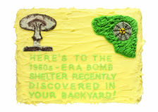 Fallout Cake. Humorous cake depicting the discovery of a bomb shelter in the backyard Royalty Free Stock Photos