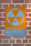 Fallout Shelter. Sign on brick wall Stock Photos