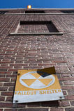 Fallout shelter. Sign outside old brick  building in new york city Stock Photo