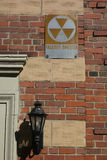 Fallout Shelter. A fallout shelter sign, with a nuclear symbol, on a New York City building Royalty Free Stock Photography