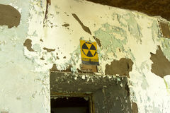 Fallout Shelter in decaying building. Fallout shelter sign over doorway in decaying building stock photography