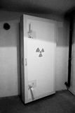Fallout Shelter Door. A black and white image of an atomic fallout shelter door with its thick cement protective layer and double handle latches Royalty Free Stock Photos