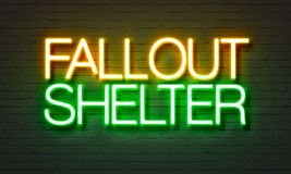 Fallout shelter neon sign on brick wall background. Royalty Free Stock Images