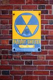 Fallout Shelter Sign. A weathered sign announcing a fallout shelter on an abandoned building on the Eastern seabord of the USA Stock Photo