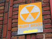 Fallout shelter sign. Vintage fallout shelter sign attached to side of brick building Stock Photo