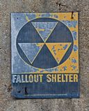 Fallout Shelter Sign. Ancient weathered fallout shelter sign on abandoned cold war weapons bunker Stock Photography
