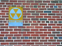 Fallout shelter sign. On brick building Stock Photography