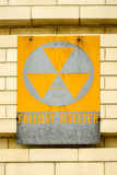 Fallout Shelter Sign. Atomic nuclear fallout shelter sign with radiation symbol on a brick wall Royalty Free Stock Photography