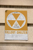 Fallout shelter sign on a building. Yellow fallout shelter sign on a building Royalty Free Stock Photography