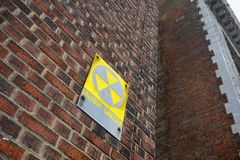 Fallout Shelter Sign on Red Brick Wall Stock Photos