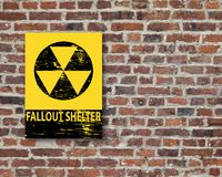 Fallout Shelter Sign On Wall. Grungy fallout shelter sign on brick wall Stock Images