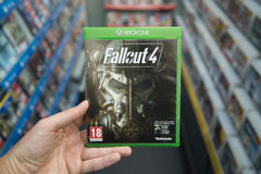 Fallout 4 videogame on XBOX One. Bratislava, Slovakia, circa april 2017: Man holding Fallout 4 videogame on Microsoft XBOX One console in store Stock Photo