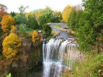 Falls in Autumn. Pretty falls and scenery with bridge and trees in the fall stock photo