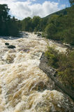 Falls of Dochart, Scotland. Stormy water at falls of Dochart, Scotland stock image