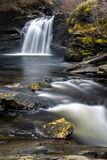 Falls of Falloch. Waterfall and river flowing over rocks in Scottish highlands Stock Photos