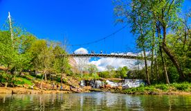 Falls Park in Downtown Greenville, South Carolina, United States. Falls Park Reedy River and Liberty Bridge Panorama stock photography