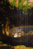 Falls and rainbow. Beautiful rainbow and falling water stock image