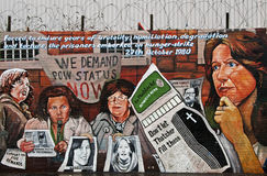 Falls Road POW Mural. The Falls Road (from Irish: tuath-na-bhFál meaning district of the falls or hedges) is the main road through west Belfast in Northern Royalty Free Stock Image