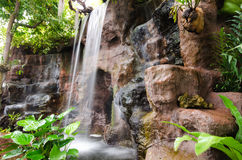 Falls of rocks in the woods. Royalty Free Stock Images