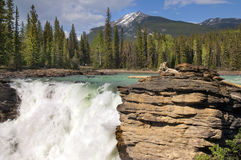 Falls in the rugged mountain river Stock Photos