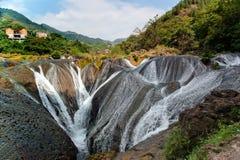 The falls shaped like pearls fall into the pit. Silver pendant Lake Falls - was taken in China's Guizhou Huangguoshu Royalty Free Stock Photo